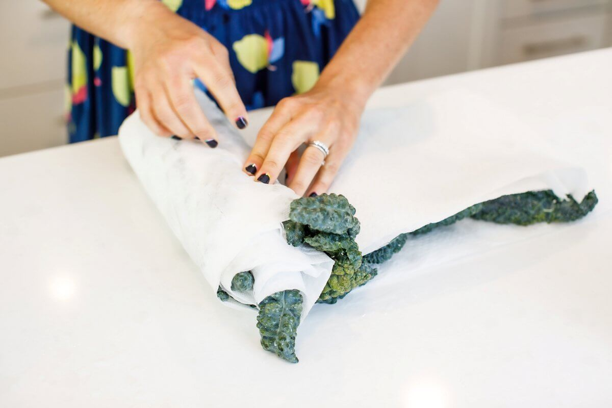 Rolling leafy greens in paper towel