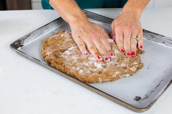floured hands on raw hermit cookie dough