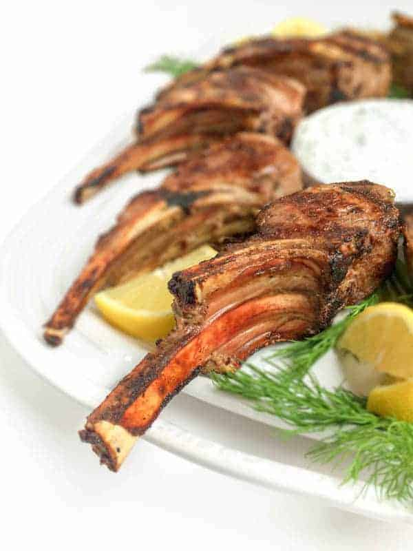 A fast 15 minute meal, your family will love these tender, grilled lamb chops served with a cool and creamy Greek tzatziki yogurt cucumber sauce. Greek Marinated Lamb Chops with Tzatziki