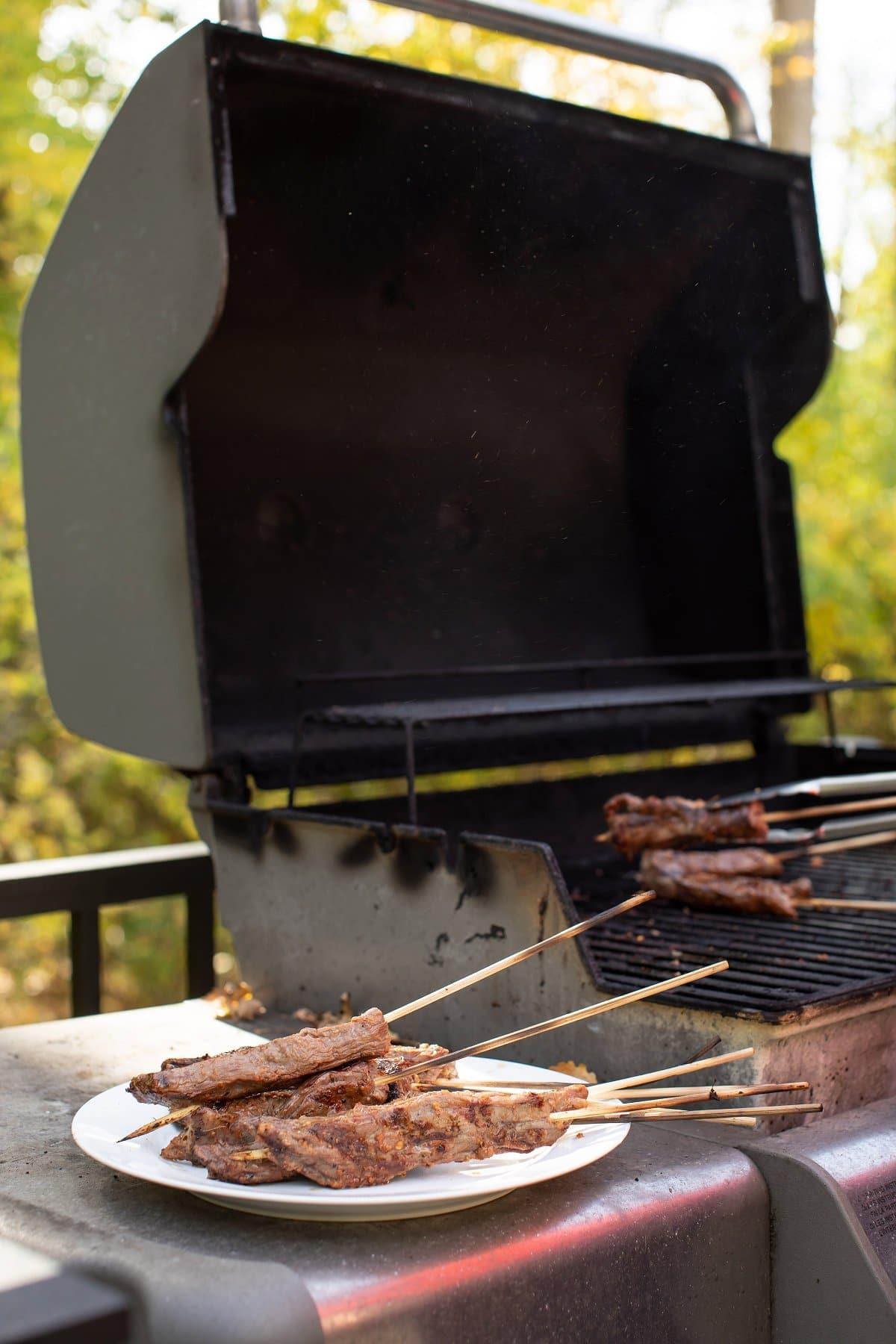 beef skewers on grill