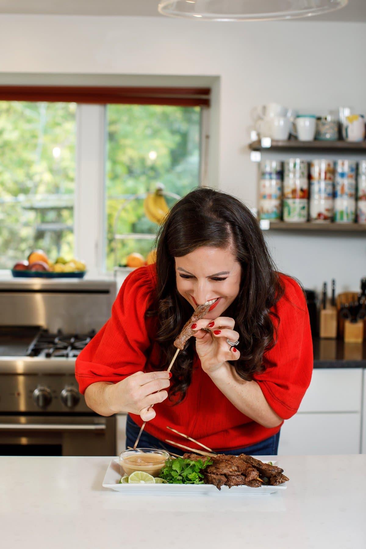 Liz eating beef skewer