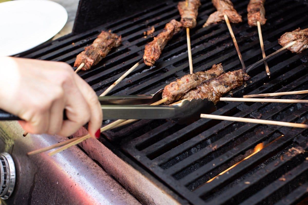 beef skewers being grilled