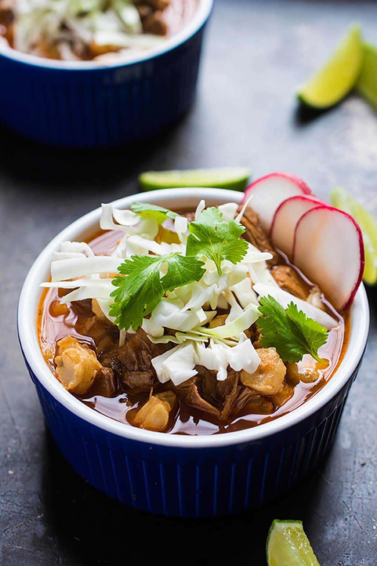 Posole Rojo - Pork and Hominy Stew in a bowl