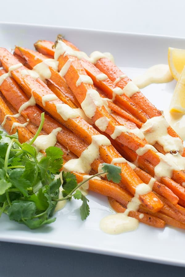 Moroccan Spiced Roasted Carrots with Lemon Yogurt Sauce - a flavorful side dish recipe
