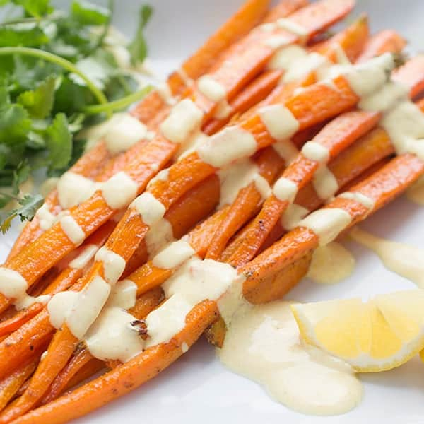 Moroccan Spiced Roasted Carrots with Yogurt Vinaigrette - a delicious side dish recipe