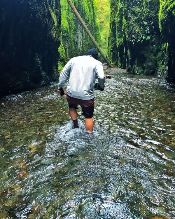 Raul Walking Through Water in Hood River