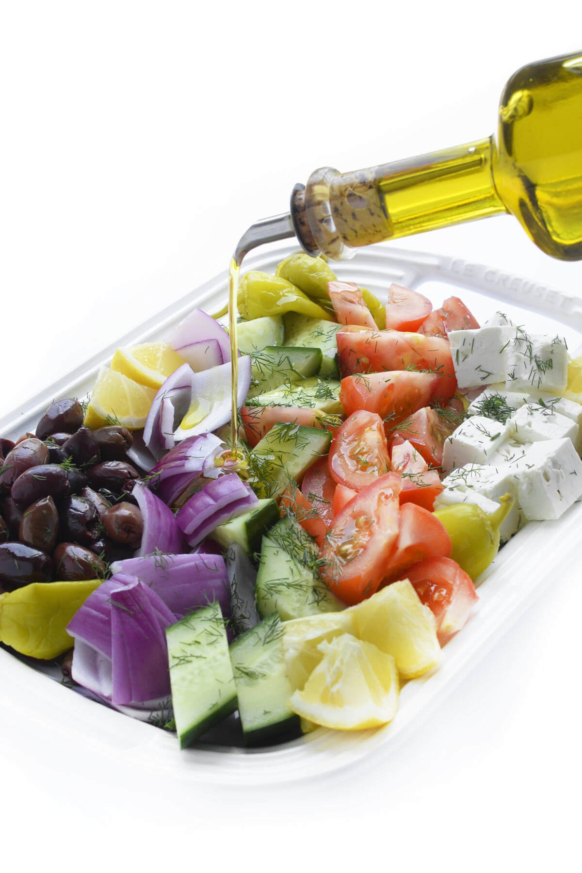 greek village salad with olive oil drizzle