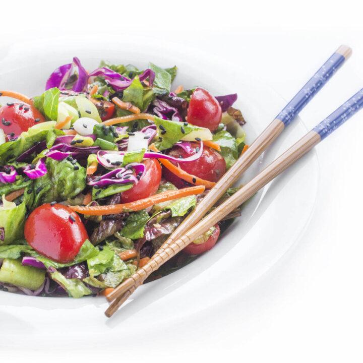 Ginger Salad Dressing on asian salad with chopsticks