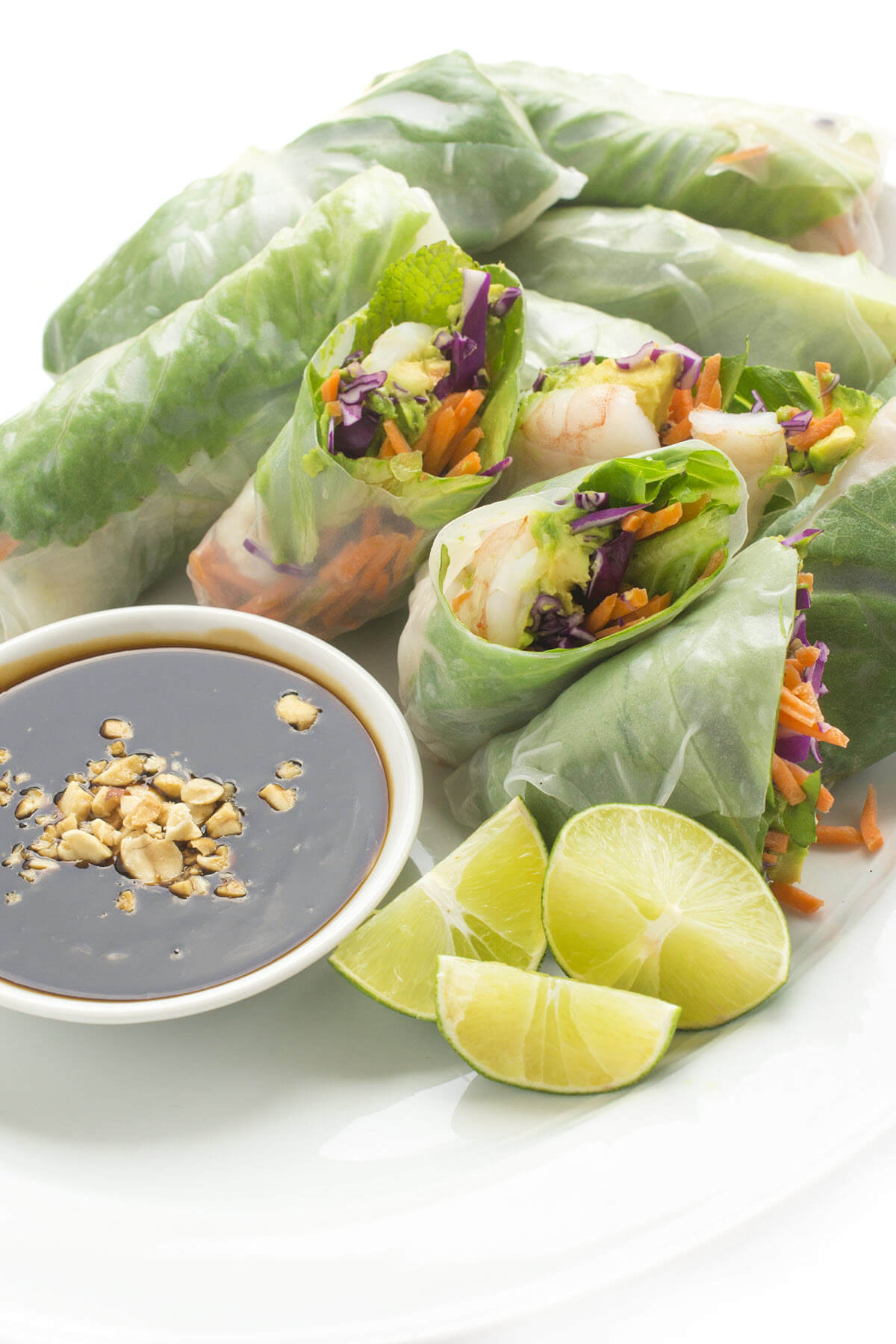 Vietnamese spring rolls on a plate with hoisin sauce