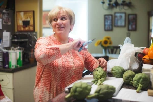 Aunt Dolly preparing Stuffed Artichokes