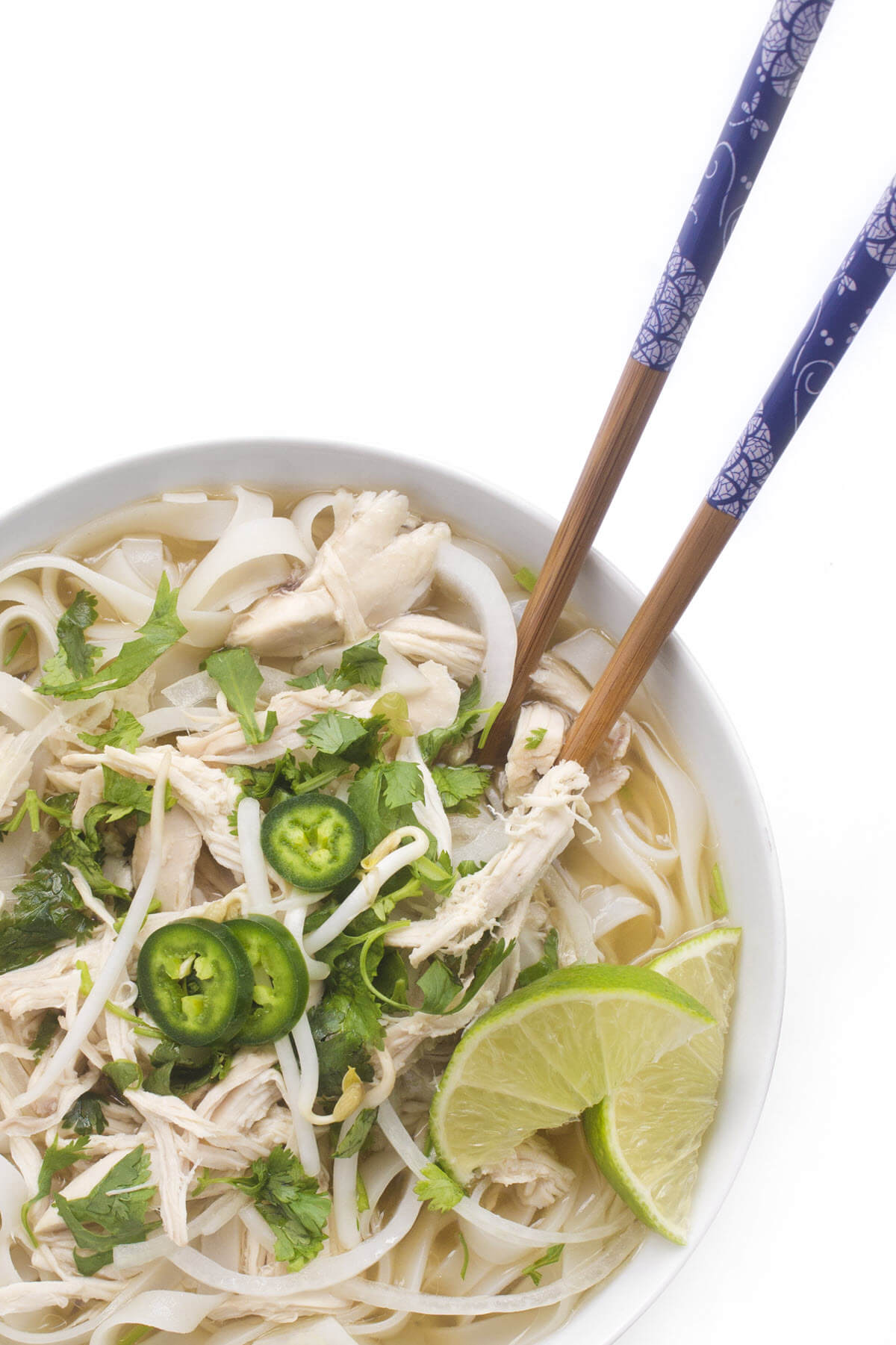 slow cooker chicken pho with chopsticks