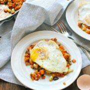 Cauliflower and Sweet Potato Hash with Fried Eggs - a healthy paleo breakfast recipe