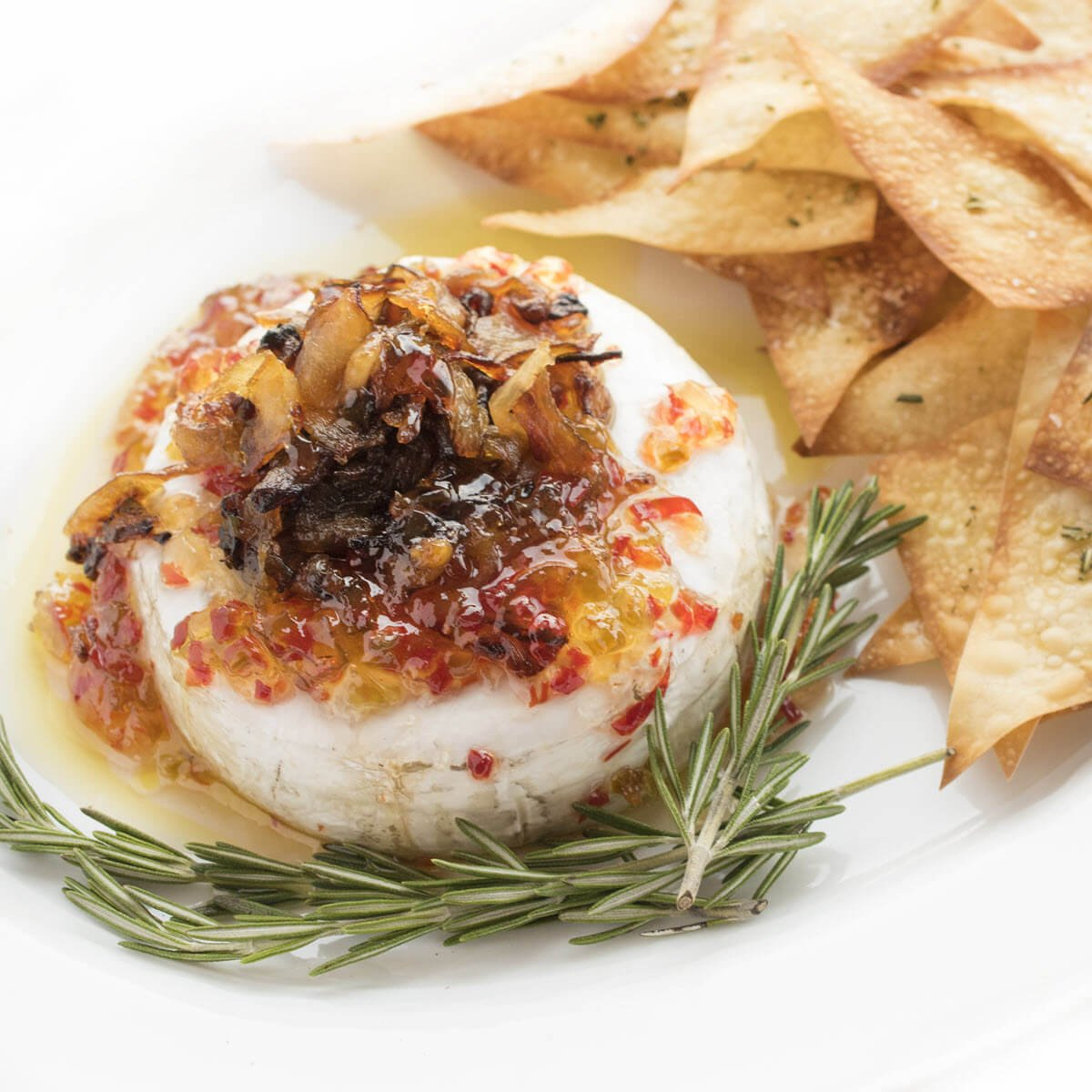 Baked Brie with Rosemary Wonton Crisps - a fast appetizer recipe