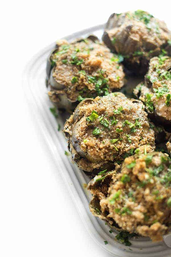 Italian Stuffed Artichokes - These Italian stuffed artichokes are made with simple pantry ingredients and result in the most comforting, crowd-pleasing side dish recipe.