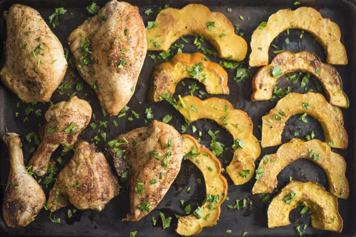 Sheet Pan Chicken and Acorn Squash on a baking sheet