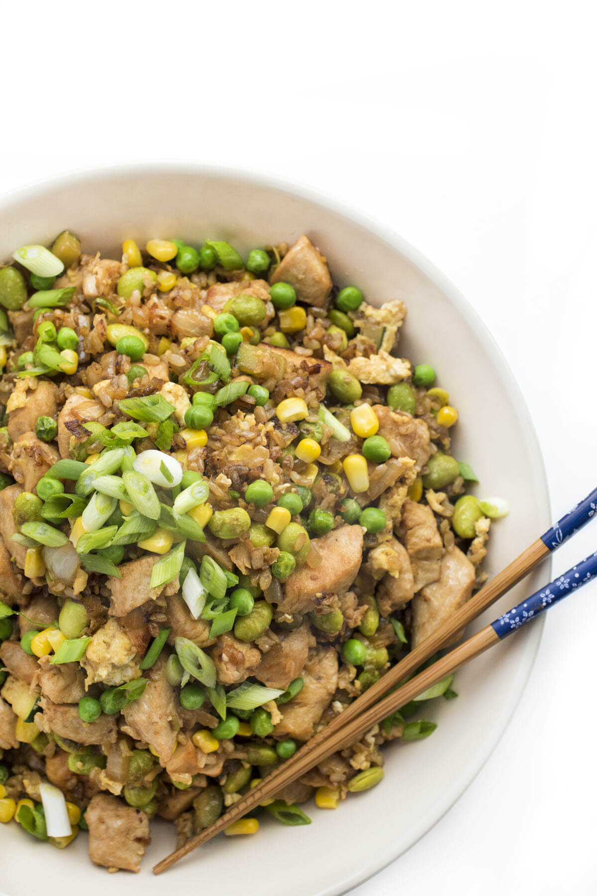 chicken fried rice with vegetables top view with chopsticks