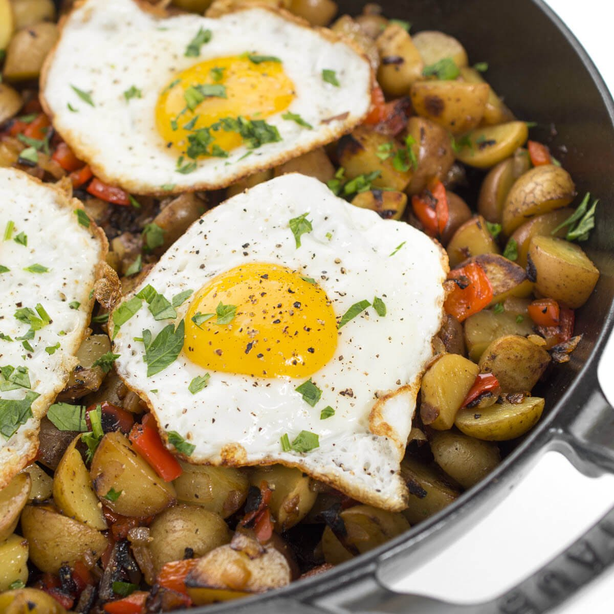 breakfast skillet with eggs potatoes peppers and onions