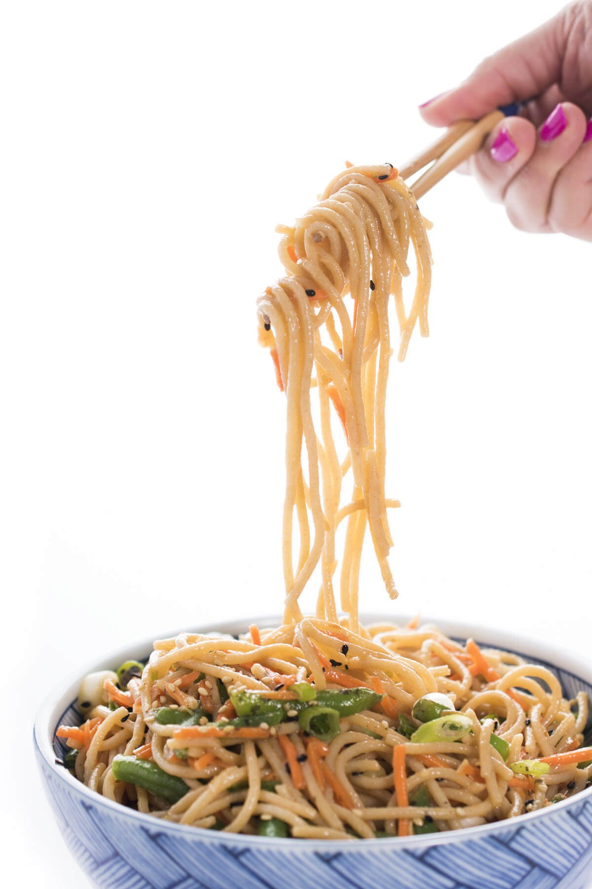 Soba Noodle Salad with soba noodles being pulled up with chopsticks