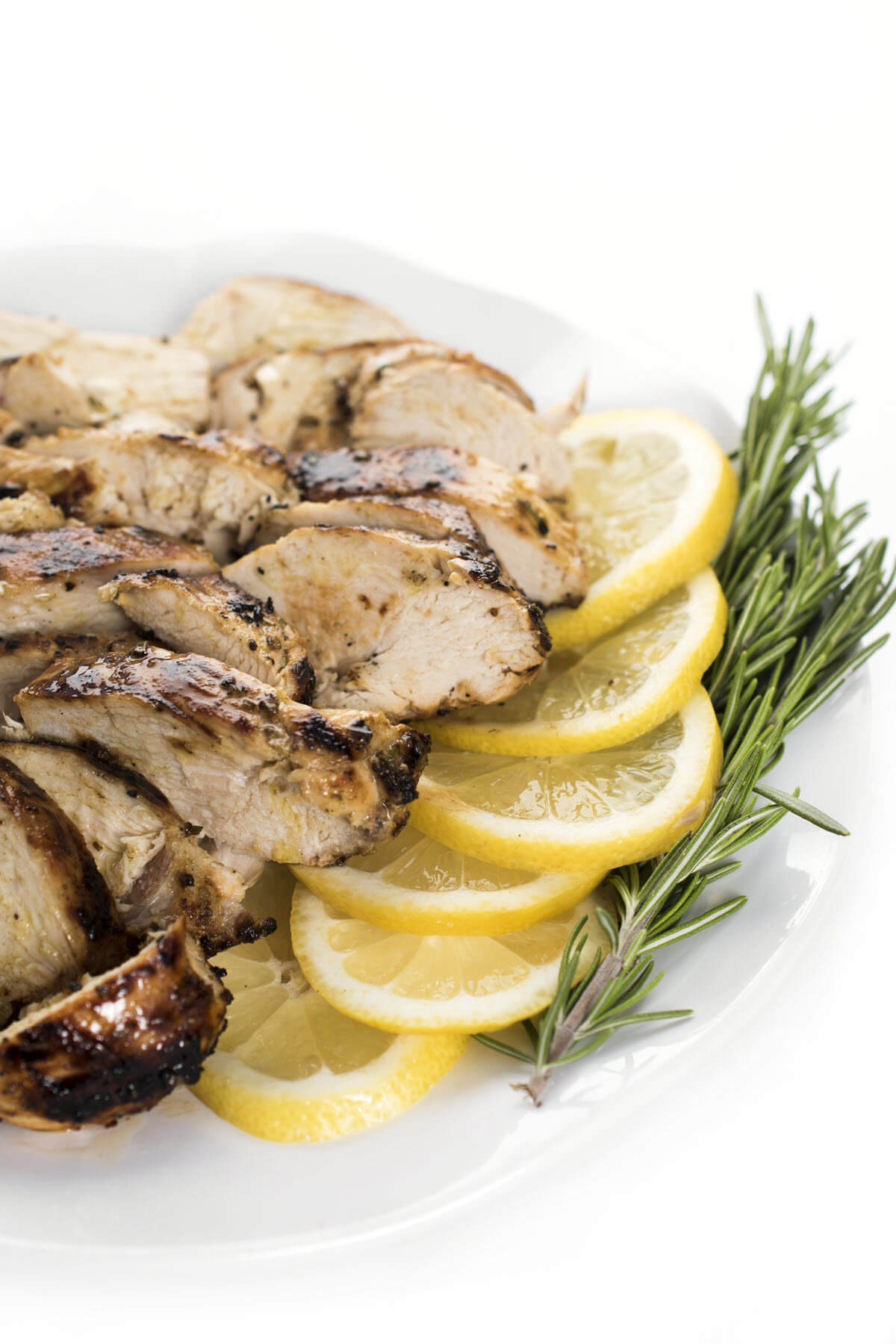 rosemary grilled chicken breasts on a plate