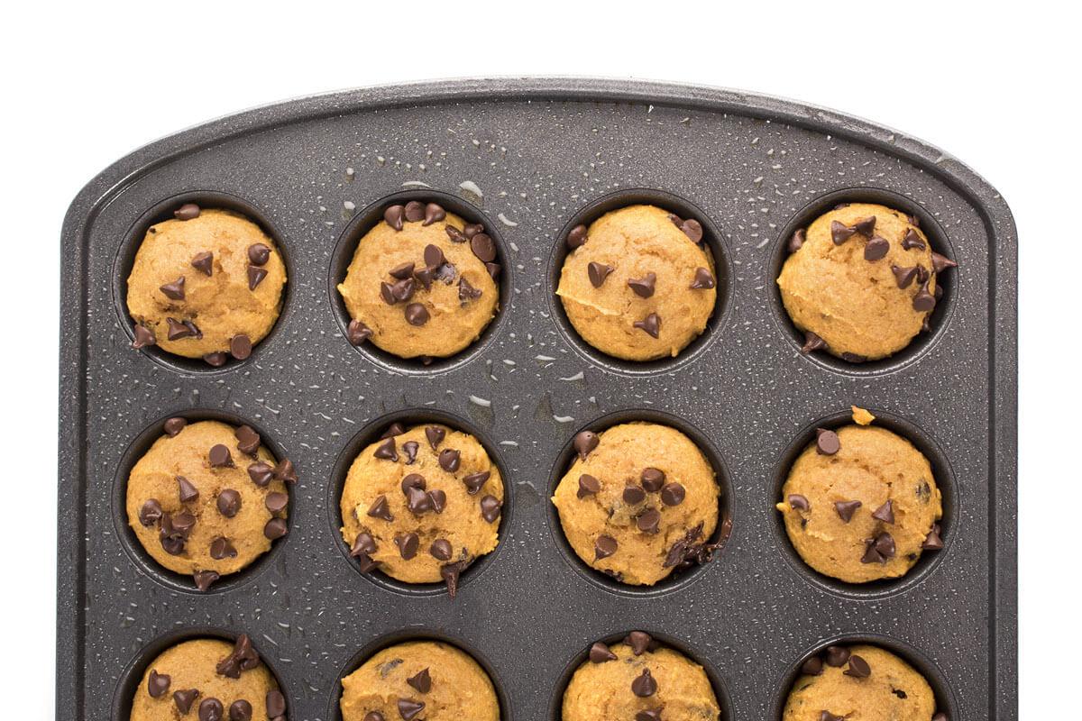 Mini Pumpkin Chocolate Chip Muffins in a muffin tin