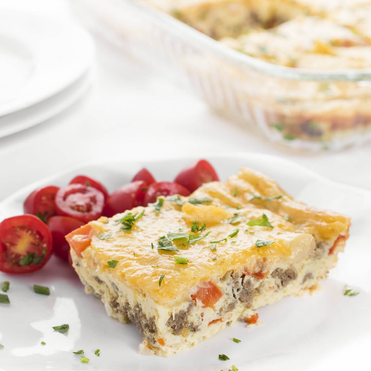 Easy Sausage and Pepper Egg Bake with tomatoes on a plate