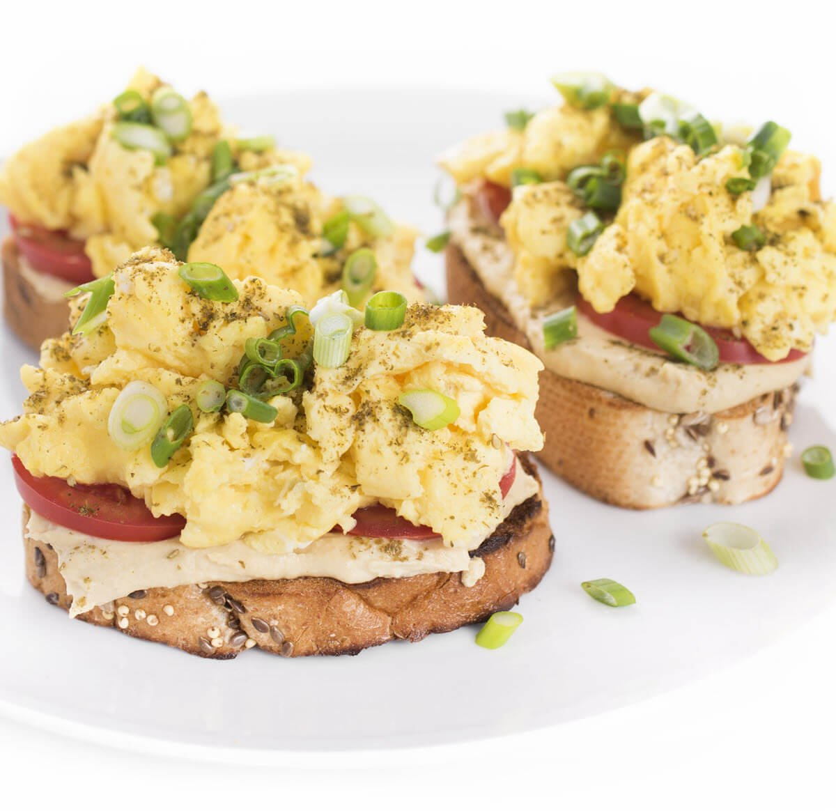 Hummus Toast with Scrambled Eggs on a plate