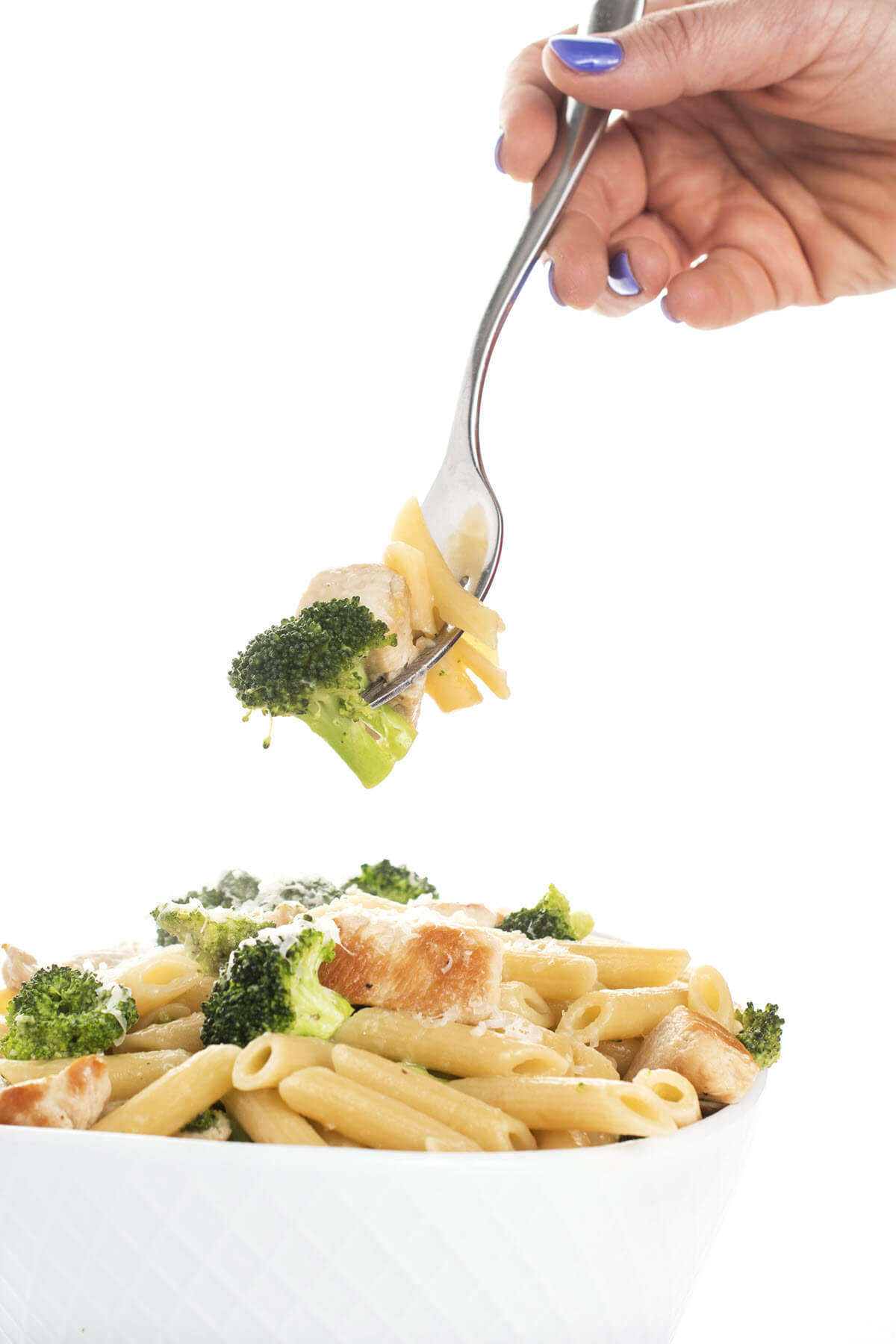 Chicken Broccoli Pasta with Lemon Butter Sauce on a fork