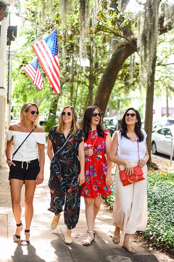 4 girls walking through Savannah Georgia