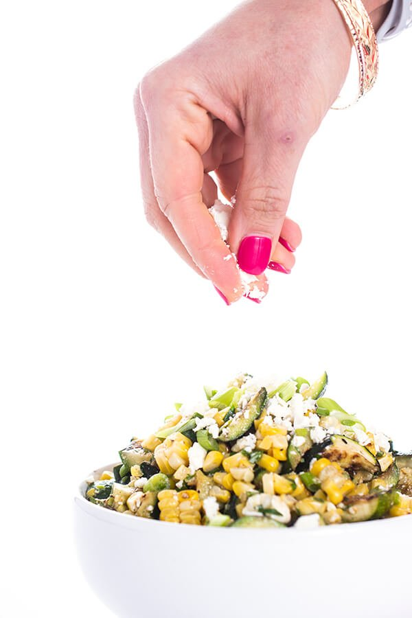 zucchini salad with feta being sprinkled in