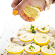 whitefish with lemon slices on top