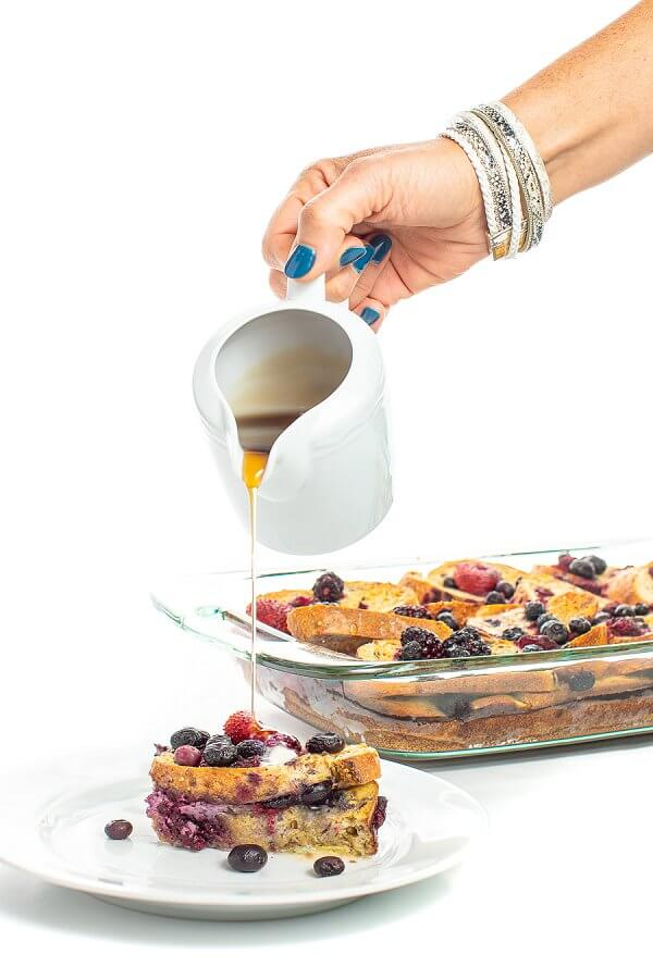 maple syrup being poured onto french toast