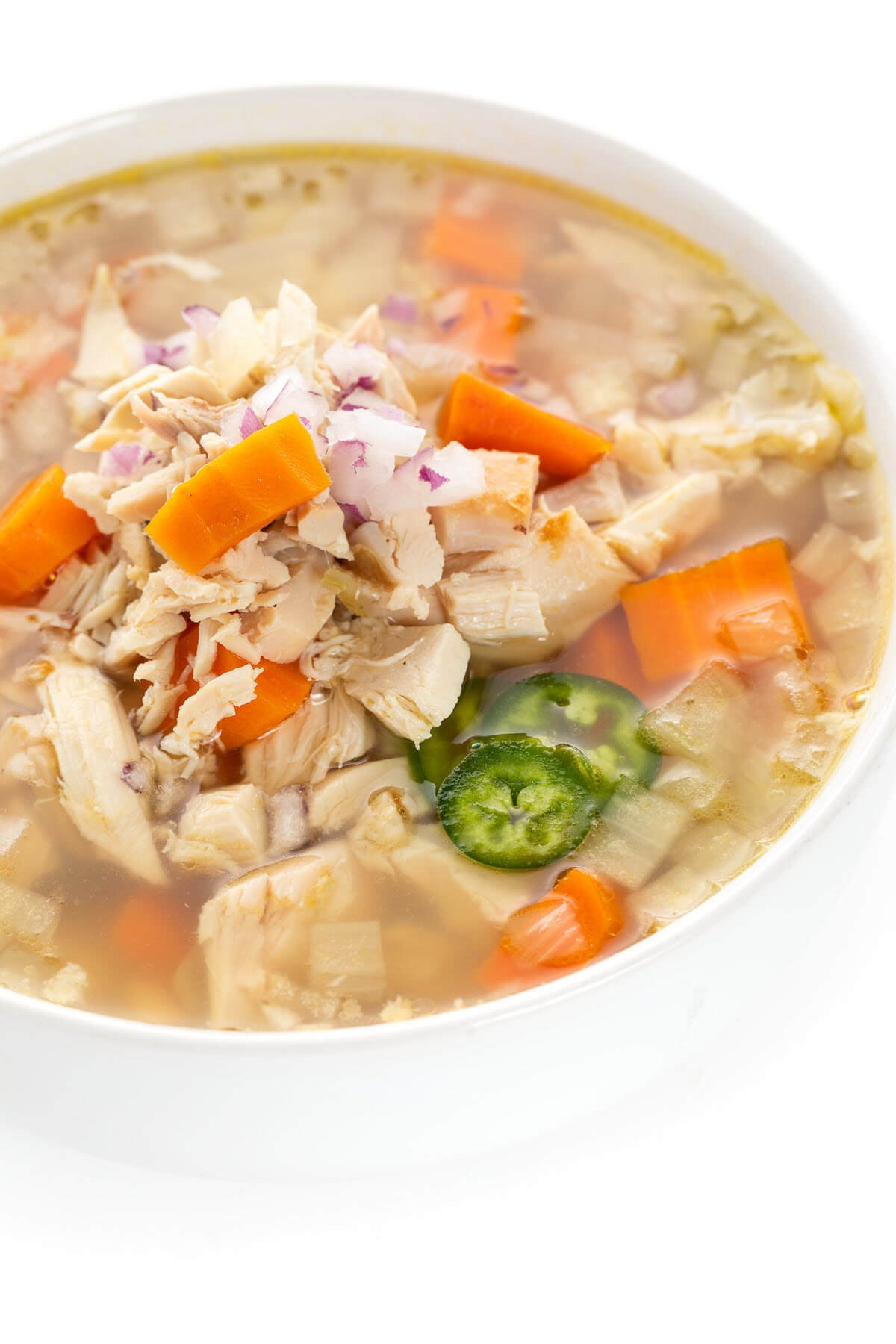 Slow Cooker Caldo de Pollo in a bowl