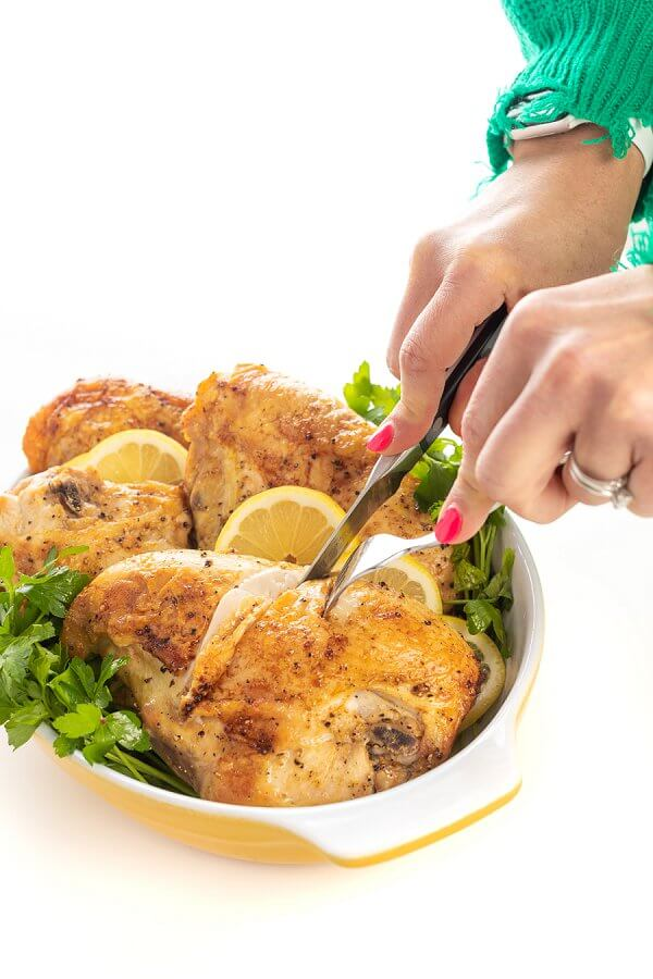 cutting into baked chicken