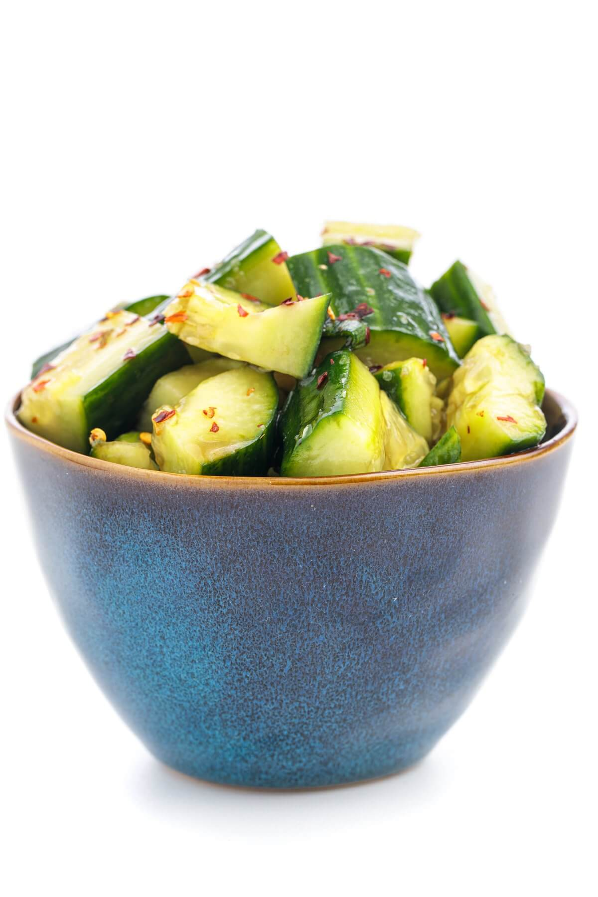 smashed cucumbers in a bowl