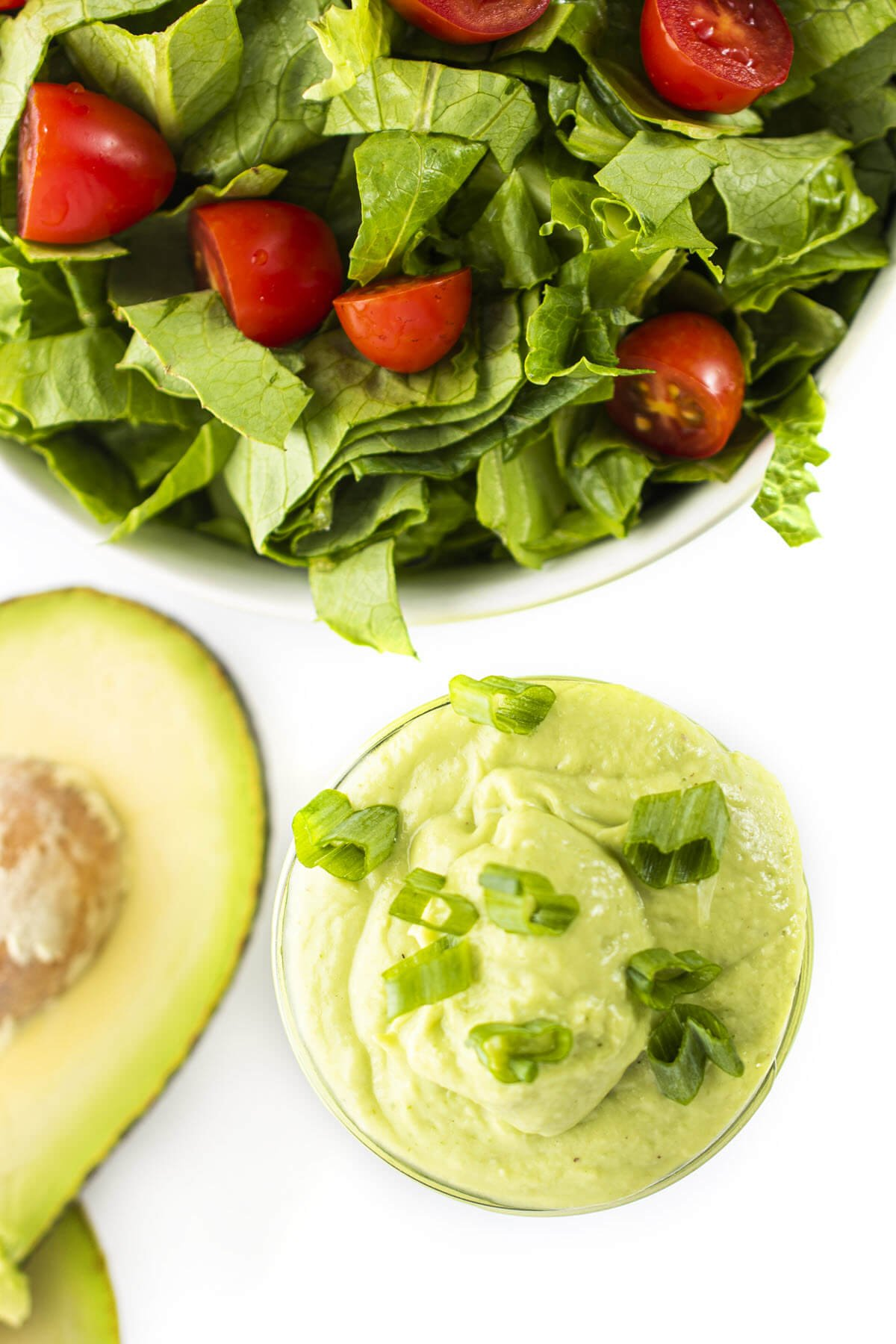 avocado dressing with salad in background