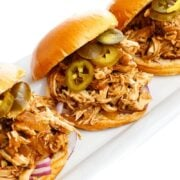 A Plate of Three Sandwiches with Slow Cooker BBQ Pulled Chicken