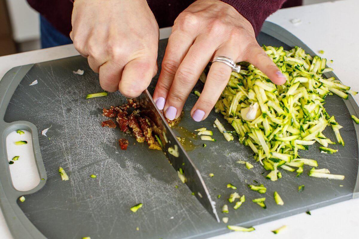 Liz chopping sun dried tomatoes
