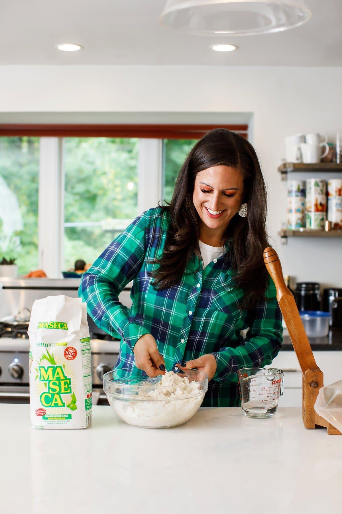Liz mixing corn tortilla ingredients