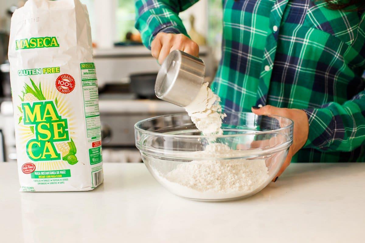 pouring flour for corn tortillas