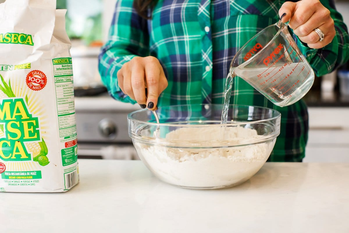 mixing flour and water for corn tortillas