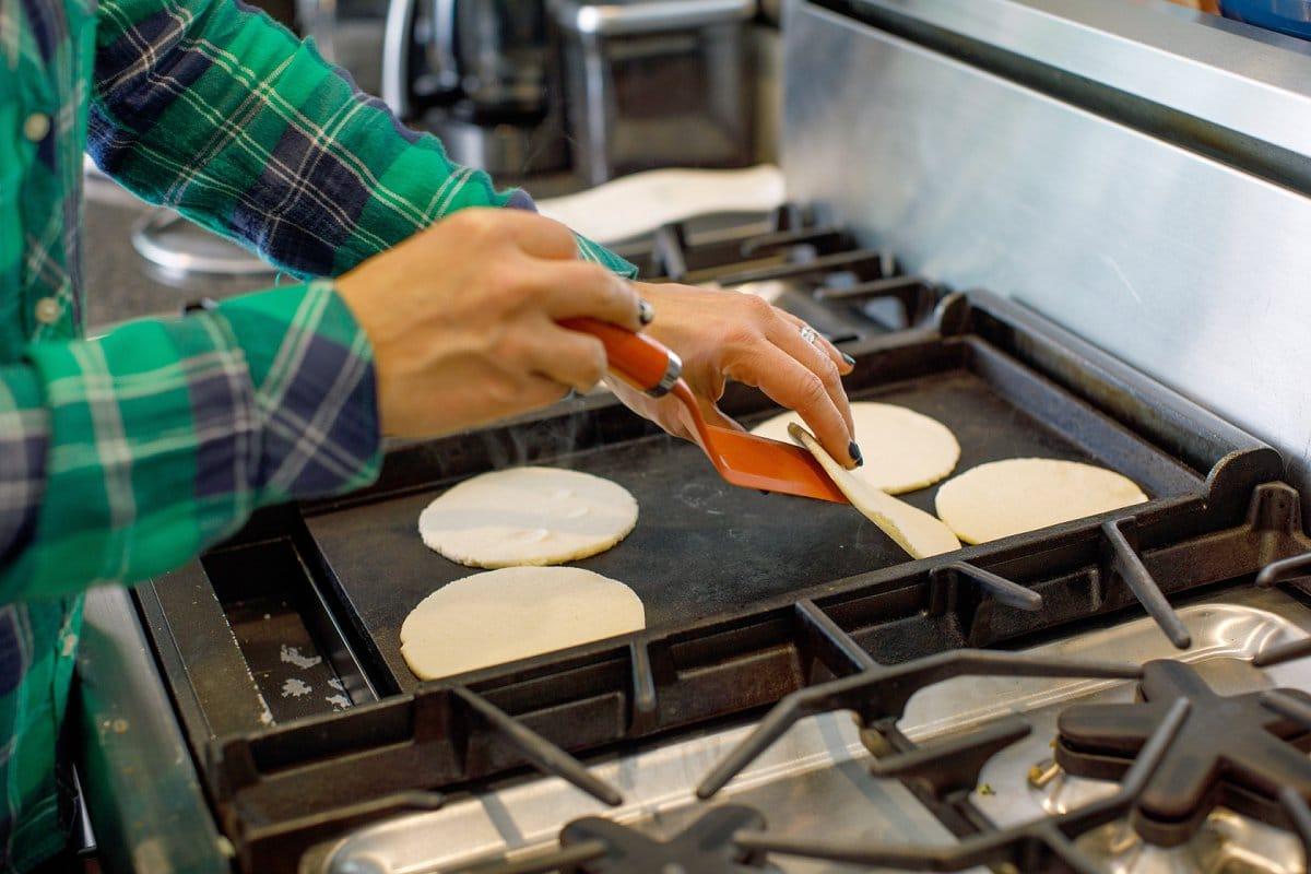 flipping corn tortillas