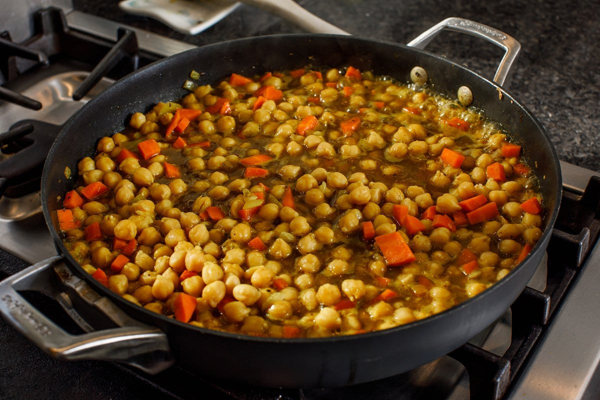 Jamaican Curry Chickpea meal simmering in skillet