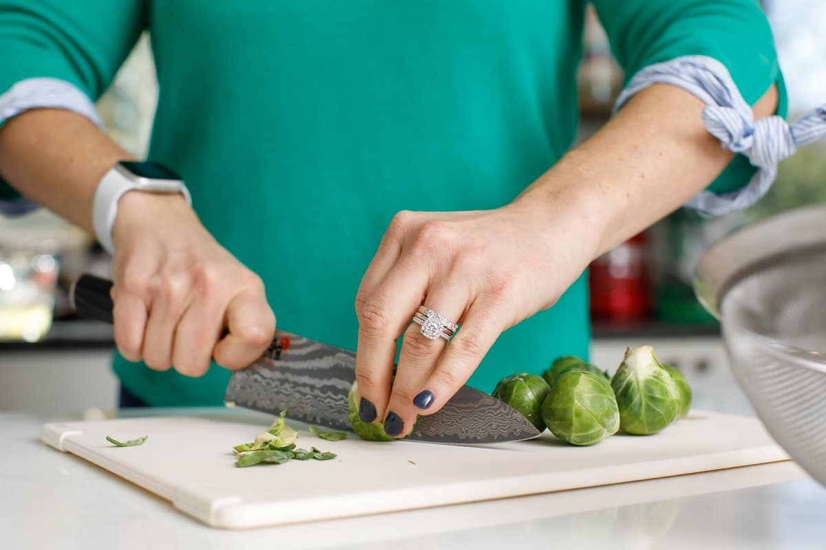 woman slicing Brussels sprouts