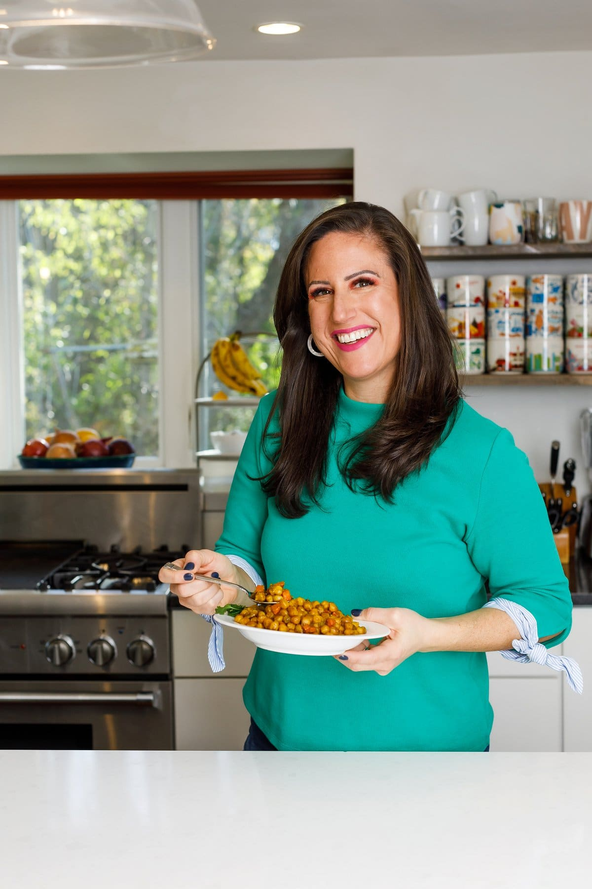 Woman holding Jamaican Curry Chickpeas