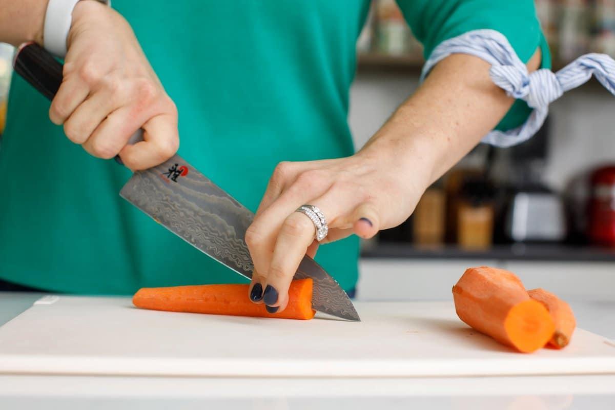 Woman slicing carrot