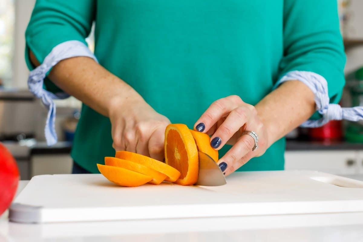 Liz slicing orange