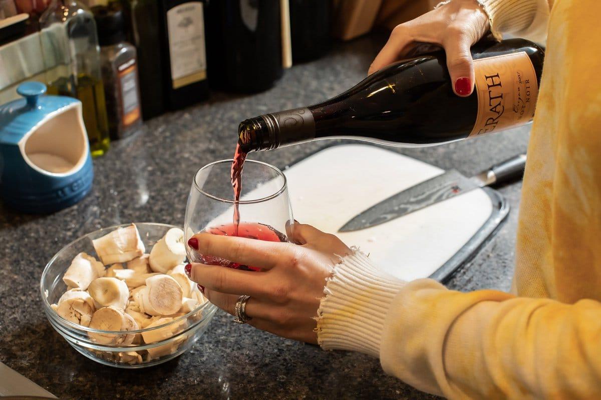 Liz pouring wine
