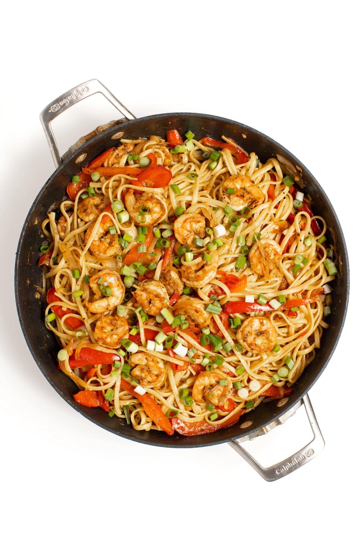 Cajun Shrimp Pasta garnished with scallions