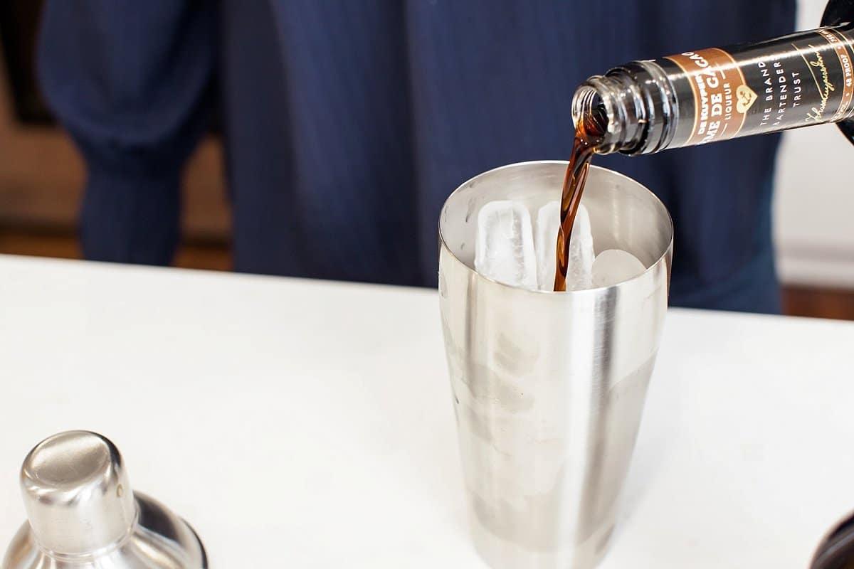 Liz pouring chocolate liqueur into a chocolate martini