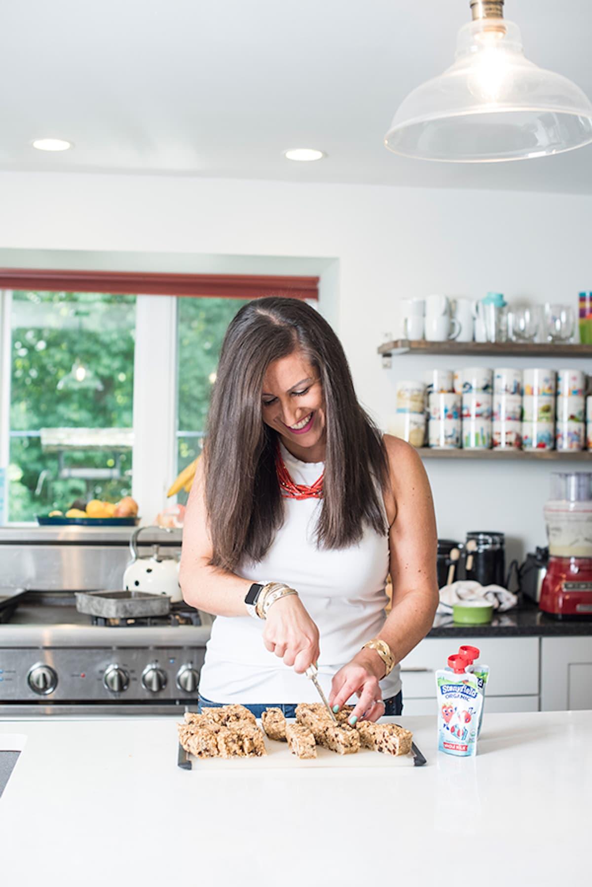 Liz cutting granola bars